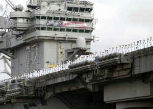 """USS Abraham Lincoln with """"Mission Accomplished"""" banner"""