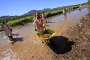 Workers cleaning up a spill in Sonora, Mexico