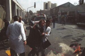 Woman being evacuated after a Jerusalem terror attack