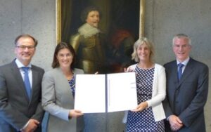 Christophe Bernasconi, Sharla Draemel, Coos 't Hoen, and Philippe Lortie with the US instrument of ratification