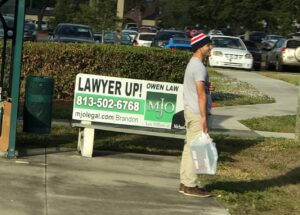 Bench with lawyer ad
