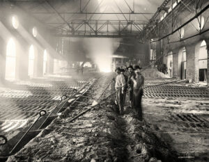Men casting pig iron, ca. 1900