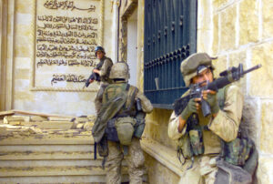 US Marines entering an Iraqi palace in Baghdad