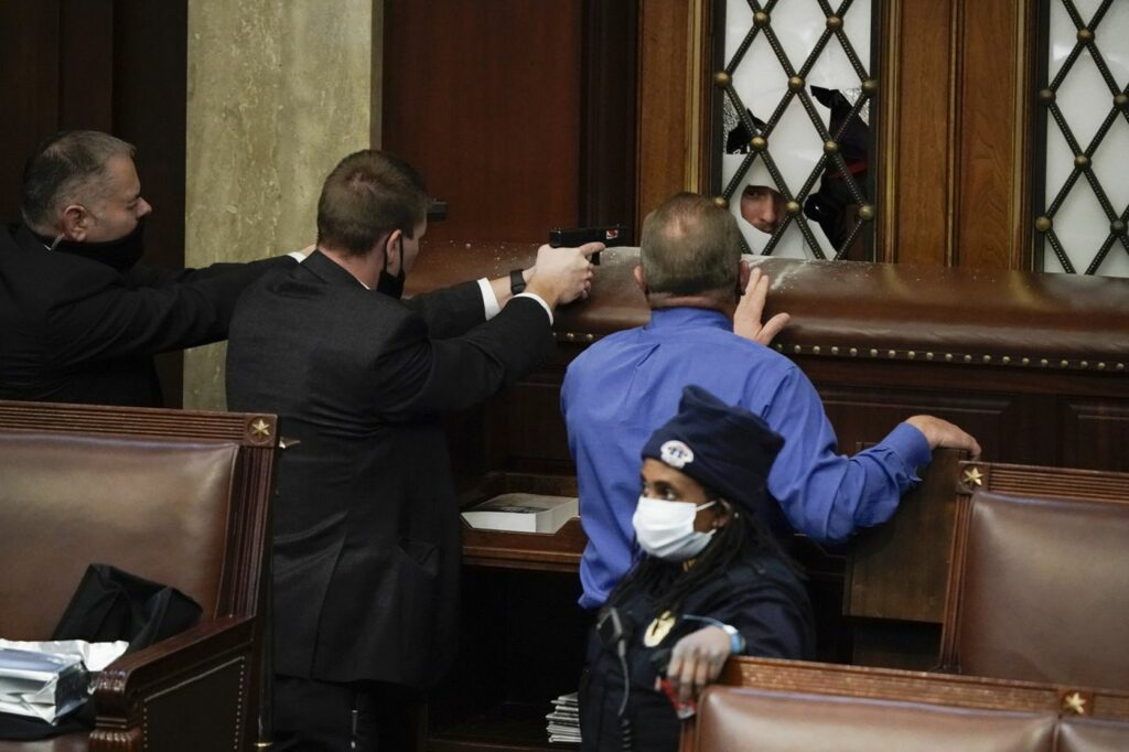 Officers with guns drawn in the House of Representatives